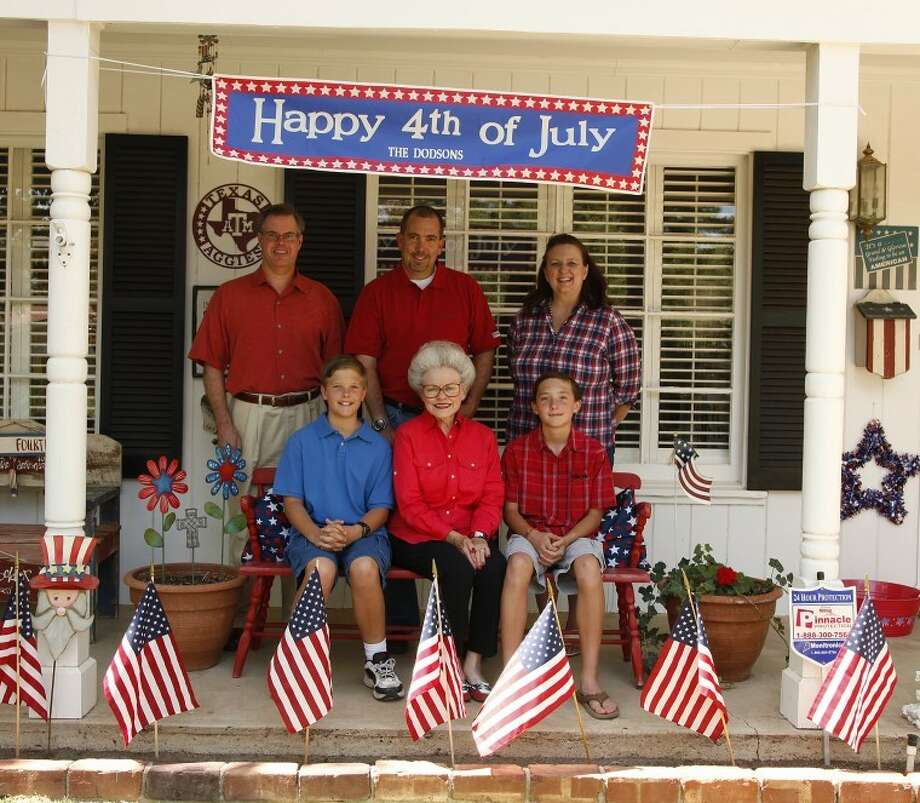 Gayle Dodson (center), coordinator of the children's parade, sits on her front porch with three past children's parade participants, Mark Edgar, back left to right, David Grace and Chrissie Mee, and twins John and Raymond Mee, 12, who will be in the parade for their last year this July 4. Chaney Mitchell/Reporter-Telegram Photo: Chaney Mitchell