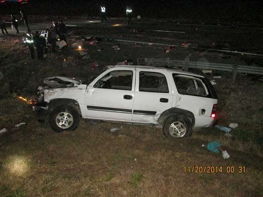 This photo provided by the Louisiana State Police shows the wreckage of a sport utility vehicle that was involved in an accident that killed five people in Calhoun, La., Thursday, Nov. 20, 2014. A 16-year-old boy driving relatives from Texas to a vacation in Disney World apparently fell asleep at the wheel, causing the vehicle to veer off the highway and roll over, killing three children and two adults, authorities said Thursday. (AP Photo/Louisiana State Police) Photo: HOPD
