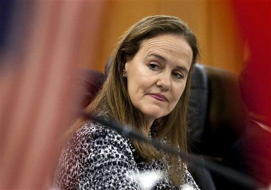 FILE - This Dec. 7, 2011 file photo shows former U.S. Defense Undersecretary Michele Flournoy, preparing for a bilateral meeting in Beijing, China. Flournoy, formerly the Pentagon's policy chief and among President Obama's more hawkish advisers, could be in line to become the first woman to lead the U.S. military after Defense Secretary Chuck Hagel's resignation. (AP Photo/Andy Wong) Photo: Andy Wong