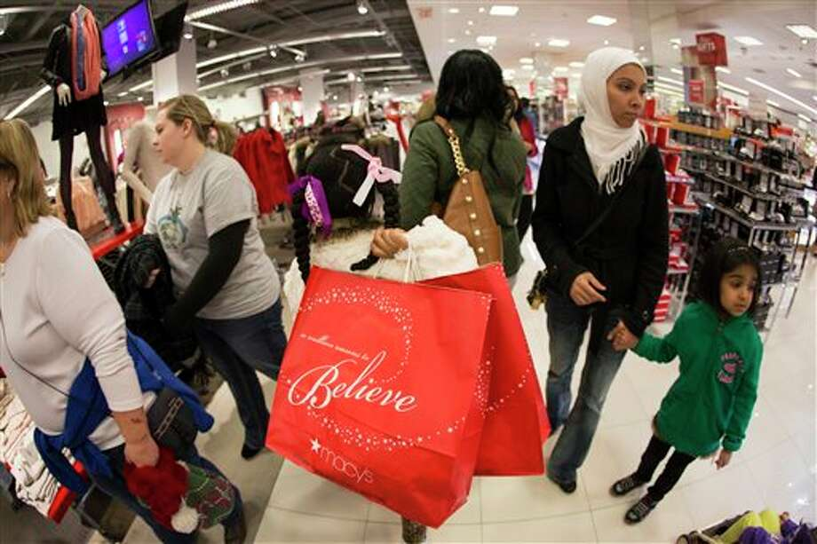 This Nov. 28, 2013 photo released by Macy's shows shoppers at the Macy's Lenox Black Friday store opening in Atlanta. In the pre-dawn hours Friday, as some early-rising shoppers were heading into malls in search of Black Friday deals, others had been up shopping all night in stores that opened the evening of Thanksgiving or at 12:01 a.m. Friday. (AP Photo/Macy's, Paul Abell) Photo: Paul Abell / Macy's