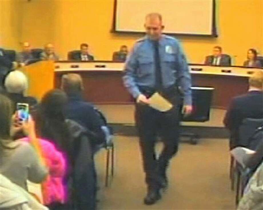 FILE - In this file Feb. 11, 2014 image from video released by the City of Ferguson, Mo., is officer Darren Wilson at a city council meeting in Ferguson. A grand jury said Monday, Nov. 24, 2014 that it has reached a decision about whether to indict Wilsoin in the shooting death of Michael Brown, according to a lawyer for Brown's family. (AP Photo/City of Ferguson) Photo: Uncredited