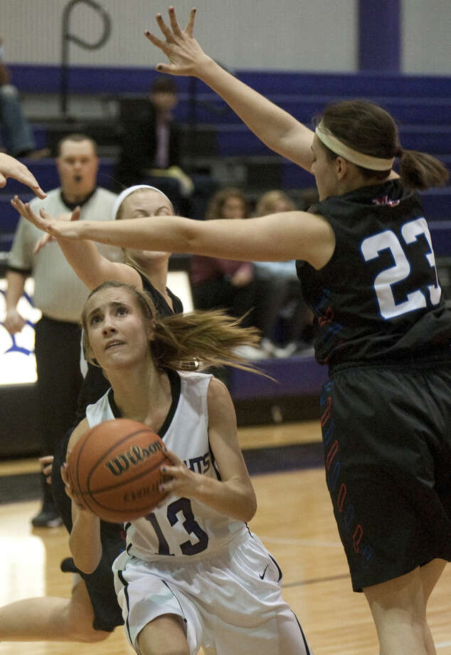 Midland Classical's Delanie Griffin ducks under the stretch of Midland Christian's Blaire Netherlin Monday evening at MCA. Tim Fischer\Reporter-Telegram Photo: Tim Fischer