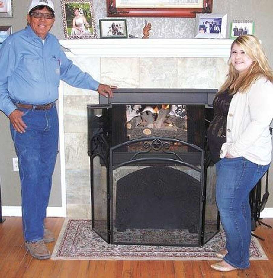 Bill's Fireplace Center owner Bill Rodriguez and his granddaughter, Chelsea, invite you to go by the showroom and see many of the gas log choices before you make your decision. The showroom is located at 1509 North Big Spring.