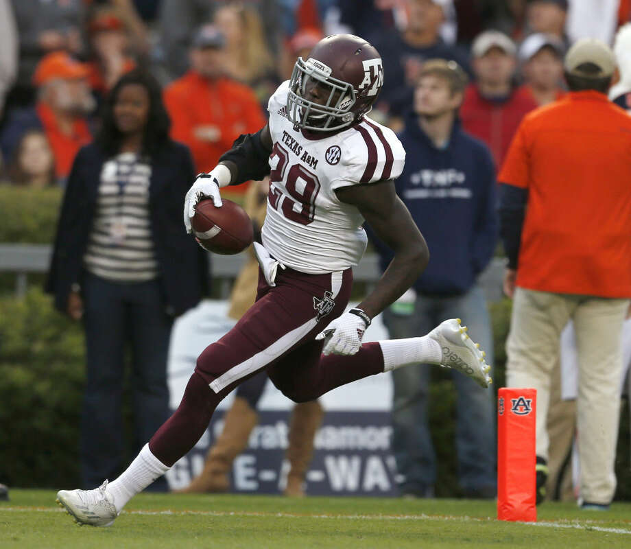 Texas A&M defensive back Deshazor Everett returns a blocked field goal for a touchdown during the first half of an NCAA college football game against Auburn on Saturday, Nov. 8, 2014, in Auburn, Ala. (AP Photo/Butch Dill) Photo: Butch Dill
