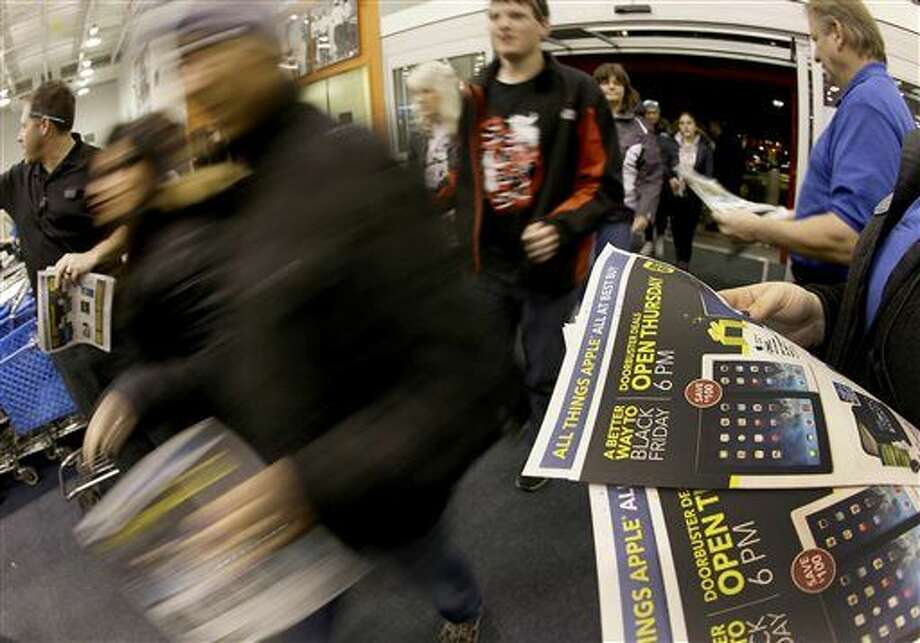 FILE - In this Thursday, Nov. 28, 2013, file photo, shoppers enter a Best Buy as the store opens on Thanksgiving Day, in Overland Park, Kan. Despite the economic tail winds, Americans remain fixated on big discounts and are cherry picking while shopping. (AP Photo/Charlie Riedel, File) Photo: Charlie Riedel