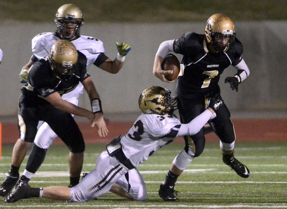 Andrews running back Eddie Gabaldon (2) is brought down by Big Spring's Garrett Wigington (33) during the first half of the Class 4A Division I area playoff game Friday at Ratliff Stadium in Odessa. James Durbin/Reporter-Telegram Photo: James Durbin