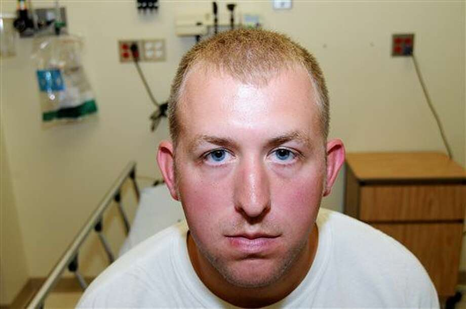 FILE- This undated file photo released by the St. Louis County Prosecuting Attorney's office on Monday, Nov. 24, 2014, shows Ferguson police officer Darren Wilson during his medical examination after he fatally shot Michael Brown,in Ferguson, Mo.The white police officer who killed Michael Brown has resigned from the Ferguson Police Department, nearly four months after the confrontation that fueled protests in the St. Louis suburb and across the U.S. Wilson has been on administrative leave since the Aug. 9 shooting. His resignation was announced Saturday, Nov. 29, 2014, by one of his attorneys, Neil Bruntrager. Bruntrager said the resignation is effective immediately. (AP Photo/St. Louis County Prosecuting Attorney's Office, File) Photo: HONS