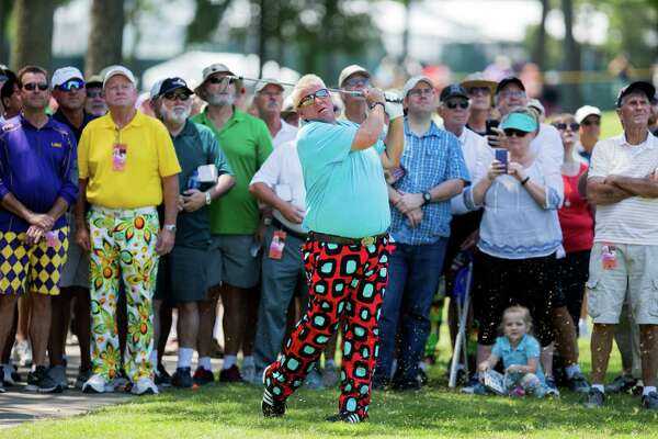 Golfer John Daly follow through from outside the fairway hole-1 during the first round of the Insperity Invitational Golf at the Woodlands Country Club, Friday, May 6, 2016, in Houston. (Juan DeLeon / For the Houston Chronicle)