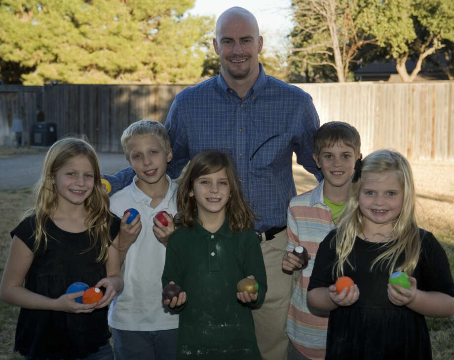 Jered Groner, brain cancer survivor, stands with his cousins and friends, Lola Lauer, Oliver Lauer, Chance Williams, Aubry Williams and Stella Lauer Monday 12-14-2015 as they show off Jered's Balls they are making and selling as stress balls to raise funds for cancer research. Tim Fischer\Reporter-Telegram Photo: Tim Fischer