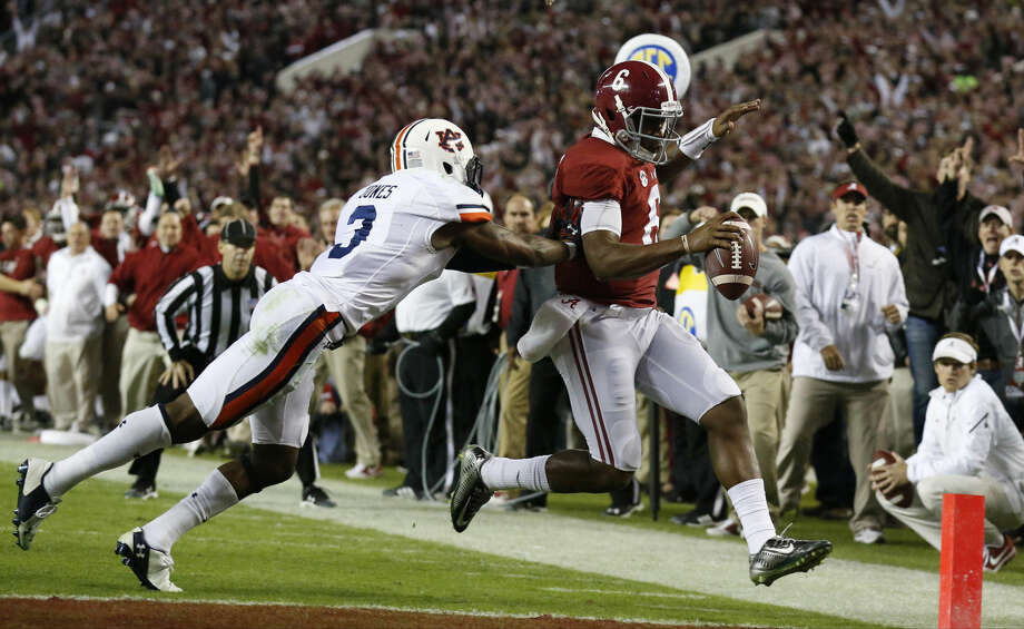 Alabama quarterback Blake Sims (6) runs into the end zone for a touchdown against Auburn defensive back Jonathan Jones (3) during the second half of the Iron Bowl NCAA college football game, Saturday, Nov. 29, 2014, in Tuscaloosa, Ala. (AP Photo/Brynn Anderson ) Photo: Brynn Anderson