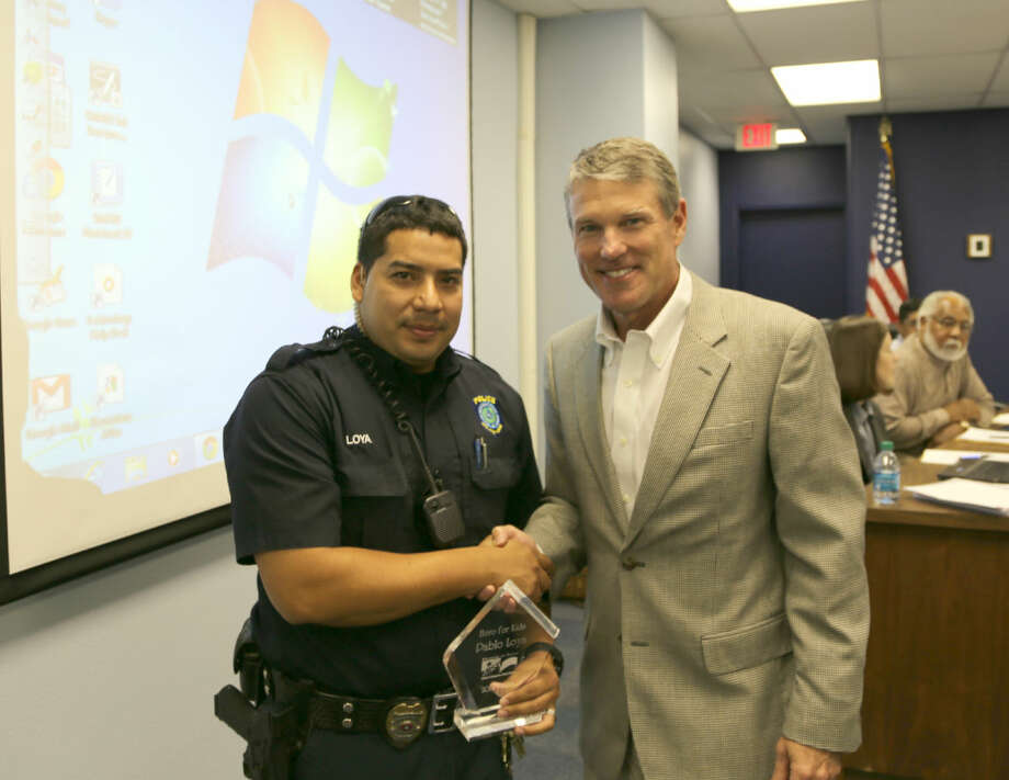 Midland ISD board President Rick Davis presented Heroes for Kids awards at a recent school board meeting. Fannin Elementary PE teacher Jay Sherrill was recognized for performing the Heimlich maneuver on a student who choked on a meatball in the cafeteria. District police officers Lupe Sanchez and Pablo Loya were recognized for their actions after a Midland High School student cut himself on a pane of glass. Photo: Courtesy Photo