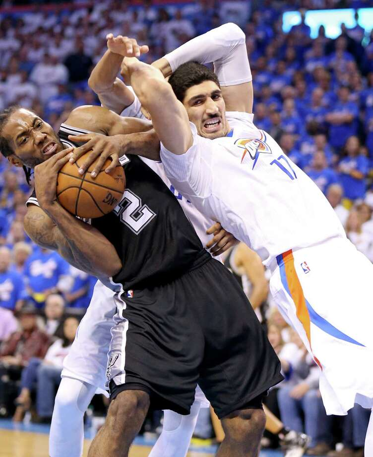 San Antonio Spurs' Kawhi Leonard and Oklahoma City Thunder's Enes Kanter struggle for control of the ball during second half action of Game 3 in the Western Conference semifinals Friday May 6, 2016 at Chesapeake Energy Arena in Oklahoma City, Oklahoma. The Spurs won 100-96. Photo: Edward A. Ornelas, Staff / San Antonio Express-News / © 2016 San Antonio Express-News