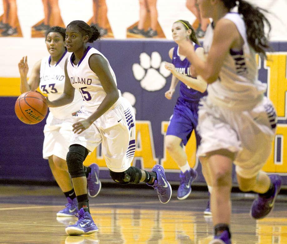 Midland High's Alexandrea Washington (15) takes the ball down the court against Abilene Wylie on Tuesday at MHS. James Durbin/Reporter-Telegram Photo: James Durbin