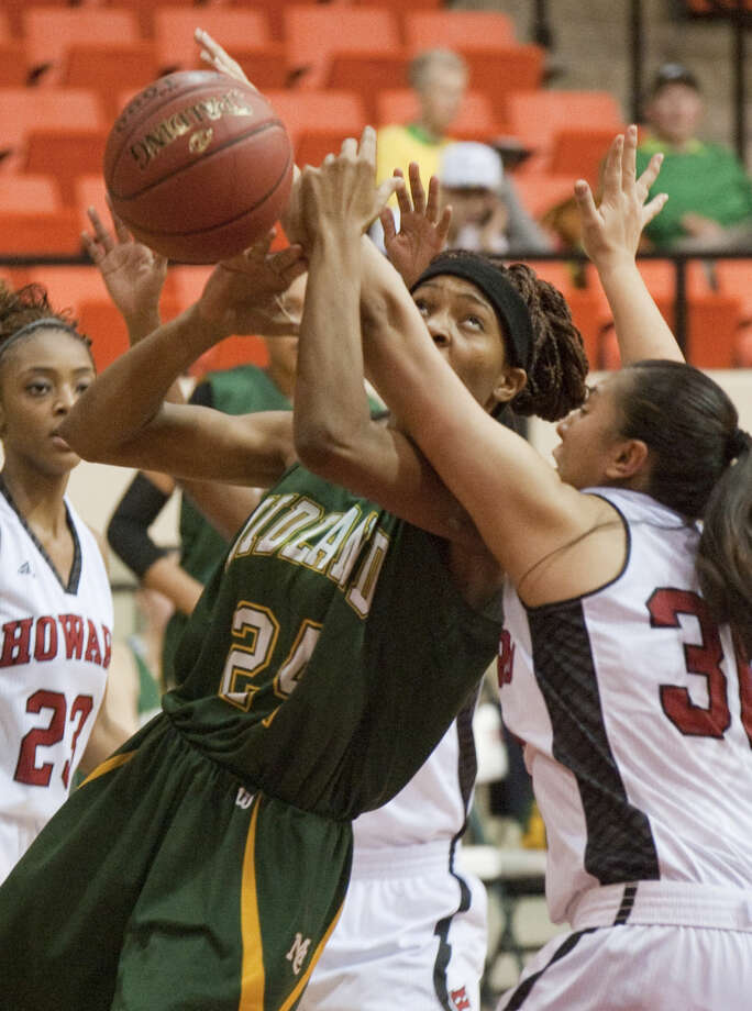 Midland College's Walnatia Wright gets fouled by Howard College's Victoria Castellanos going up for a shot Wednesday evening at Dorothy Garrett Coliseum. Tim Fischer\Reporter-Telegram Photo: Tim Fischer