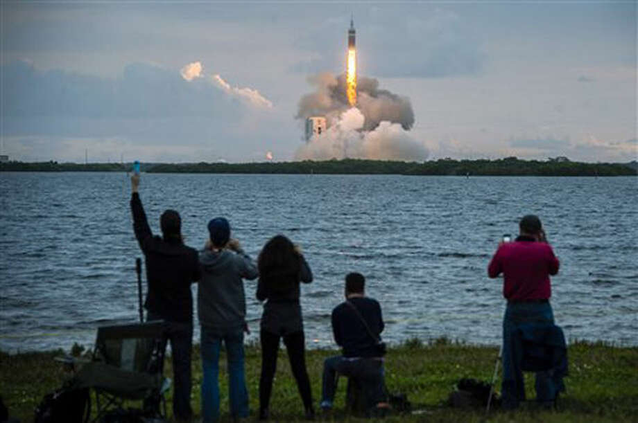 Spectators cheer as the United Launch Alliance Delta 4-Heavy rocket, with NASA's Orion spacecraft mounted atop, lifts off from the Cape Canaveral Air Force Station Friday, Dec. 5, 2014, in Cape Canaveral, Fla. (AP Photo/Houston Chronicle, Smiley N. Pool) MANDATORY CREDIT Photo: Smiley N. Pool
