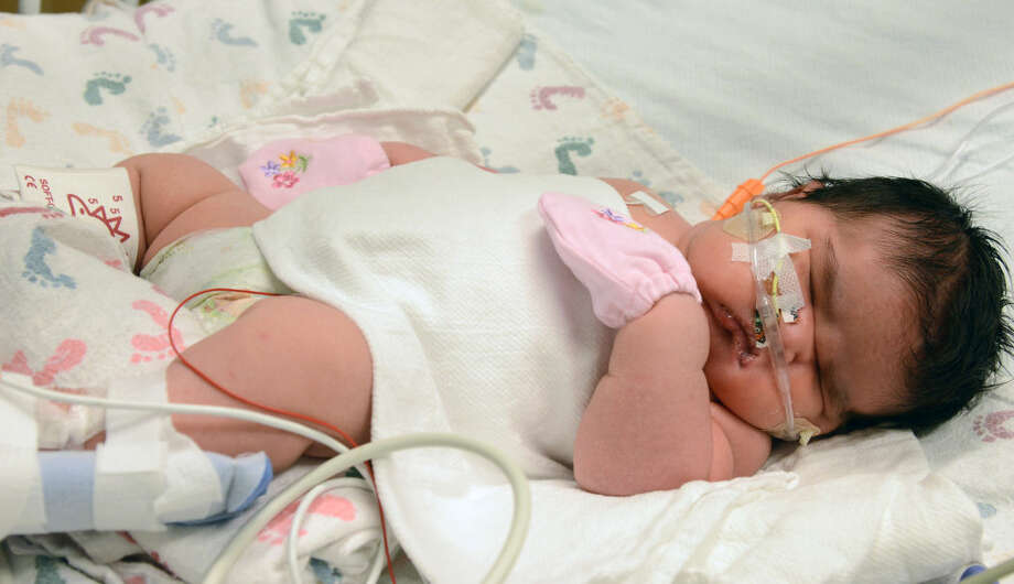 Mia Yasmin Garcia was born Dec. 2 in Alamosa, Colorado, and weighed 13 pounds, 13 ounces. The daughter of Alisha Hernandez and Francisco Garcia was delivered via  cesarean section. Photo:  AP Photo/Children's Hospital Colorado