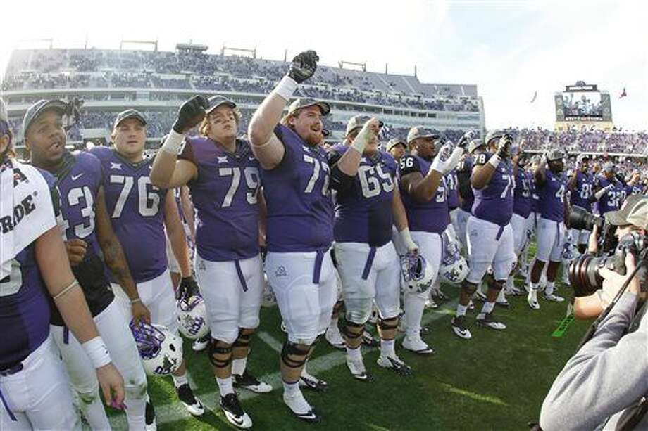 TCU players sings the school song with his teammates after after they defeated Iowa State 55-3 in an NCAA college football game against Iowa State at Amon G. Carter Stadium, Saturday, Dec. 6, 2014, in Fort Worth, Texas. (AP Photo/The Fort Worth Star-Telegram, Paul Moseley) MAGS OUT; (FORT WORTH WEEKLY, 360 WEST); INTERNET OUT Photo: Paul Moseley