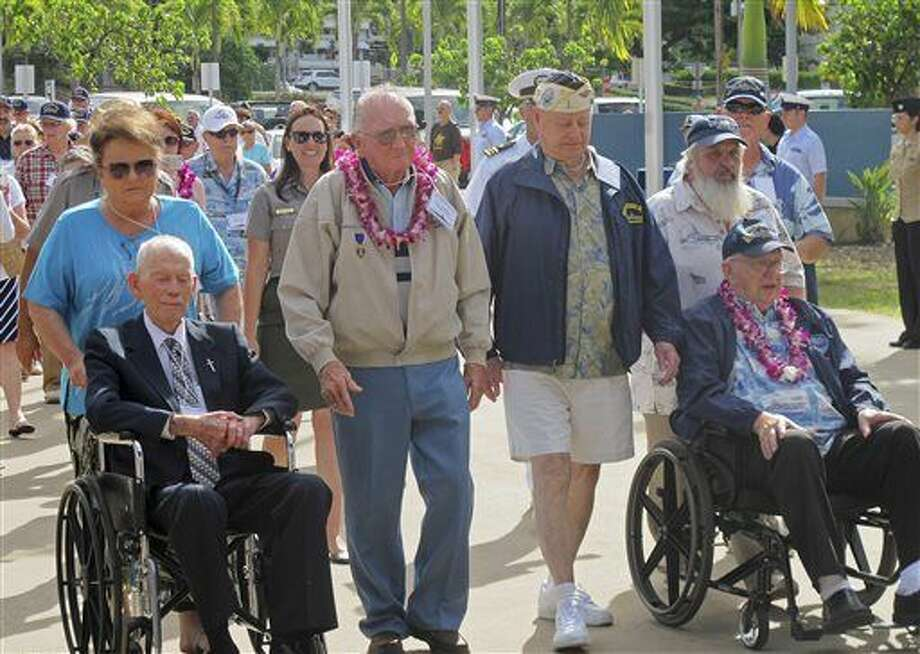 USS Arizona survivors from left, John Anderson, Don Stratton, Louis Conter and Lauren Bruner arrive Tuesday, Dec. 2, 2014, in Pearl Harbor, Hawaii. Four of the remaining nine USS Arizona survivors of the Pearl Harbor attack are vowing this year's anniversary of the 1941 attack won't be their last reunion. Even though it's the last official survivor gathering of the USS Arizona Reunion Association, the men say they still plan to get together, even if not in Hawaii. Sunday marks the 73rd anniversary of the Japanese attack that killed roughly 2,400 sailors, Marines and soldiers. (AP Photo/Audrey McAvoy) Photo: Audrey McAvoy