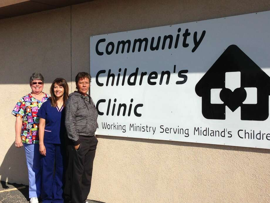 Melissa Liddle, Cherie Henderson and Lily Thompson stand outside Community Children's Clinic. Photo: Courtesy Photo