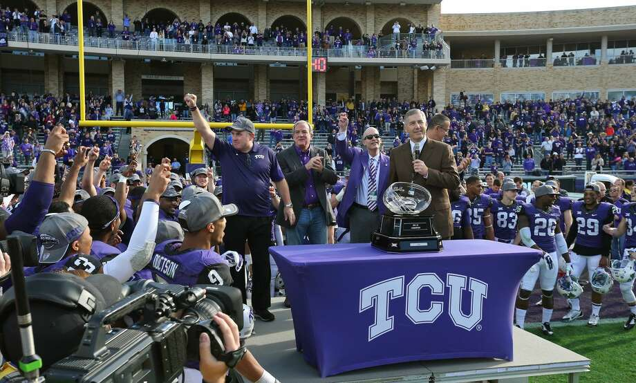 TCU head coach Gary Patterson, Chancellor Victor Boschini, second from right, and Big 12 Commissioner Bob Bowlsby get set for the trophy presentation after TCU defeated Iowa State 55-3 in an NCAA college football game against Iowa State at Amon G. Carter Stadium, Saturday, Dec. 6, 2014, in Fort Worth, Texas. (AP Photo/The Fort Worth Star-Telegram, Paul Moseley) MAGS OUT; (FORT WORTH WEEKLY, 360 WEST); INTERNET OUT Photo: Paul Moseley