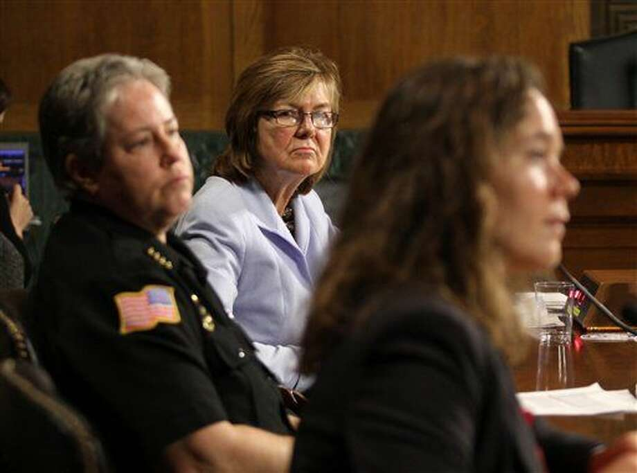 "Peg Langhammer, Executive Director, Day One in Rhode Island, center, and Police Chief Kathy Zoner, left, listen as Angela Fleischer, assistant director of Student Support and Intervention for Confidential Advising at the Southern Oregon University, right, testifies on Capitol Hill in Washington, Tuesday, Dec. 9, 2014, before the Senate Crime and Terrorism subcommittee hearing: ""Campus Sexual Assault: the Roles and Responsibilities of Law Enforcement."" Cornell University (AP Photo/Lauren Victoria Burke) Photo: Lauren Victoria Burke"