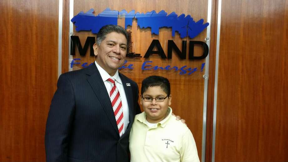 Ryan Hernandez, 11, poses with Mayor Jerry Morales after the Nov. 18 City Council meeting.