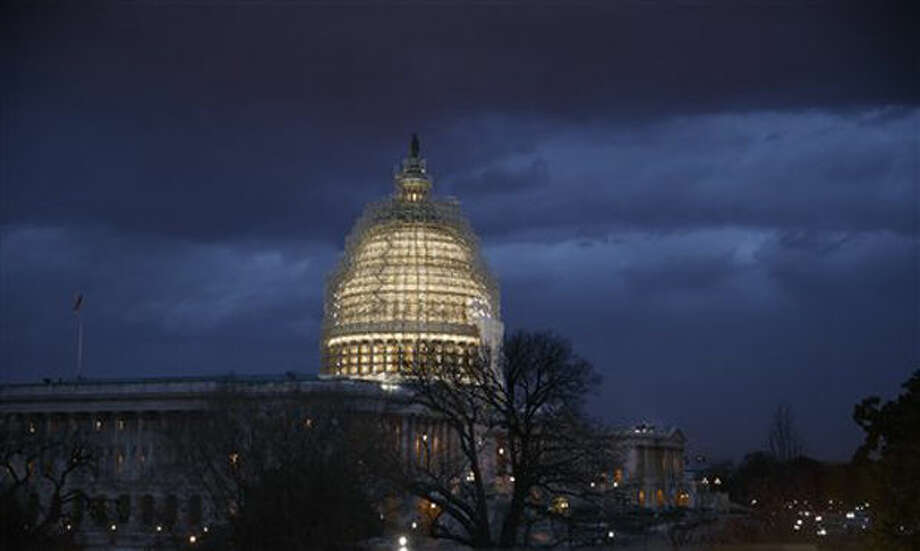 FILE - In this Dec. 1, 2014 file photo, the Capitol is seen at dusk in Washington. Americans may not agree on much lately, but one opinion is nearly universal: There's almost no chance that President Barack Obama and the Republicans in Congress can work together to solve the country's problems. A new Associated Press-GfK poll finds just 13 percent of Americans are confident the leaders on either end of Pennsylvania Avenue can work together, while 86 percent have no such faith. That's far more than the 58 percent who felt that way just after the 2010 midterm elections in which the tea party movement rose to prominence. (AP Photo/J. Scott Applewhite) Photo: J. Scott Applewhite