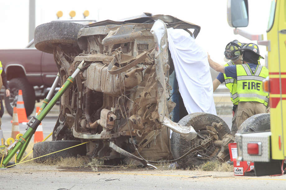Midland emergency personnel work the scene of a two-vehicle crash on the south service road of Interstate 20 on Wednesday. Two men died in the wreck. Photo: James Durbin/Reporter-Telergam