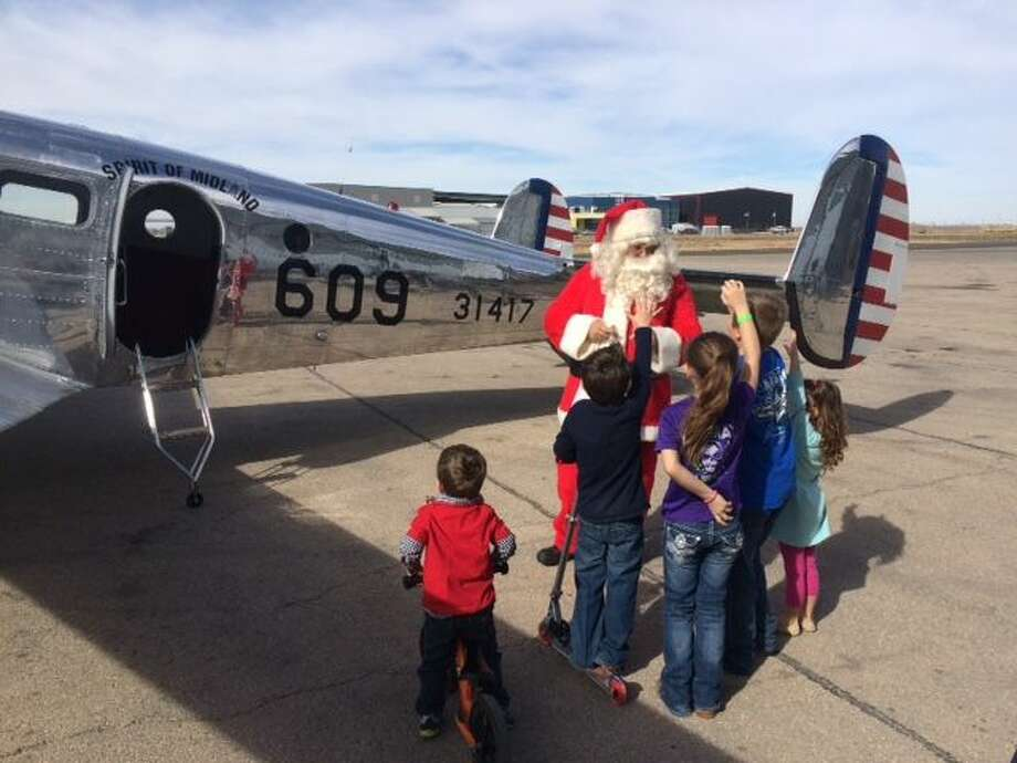 The High Sky Wing of the CAF recently hosted an event for Toys for Tots. Several hundred toys were collected and the pilots of the Wing C-45 gave rides. The Wing C-45 will be the plane used for the Christmas Lights Night Flights. Photo: Courtesy Photo