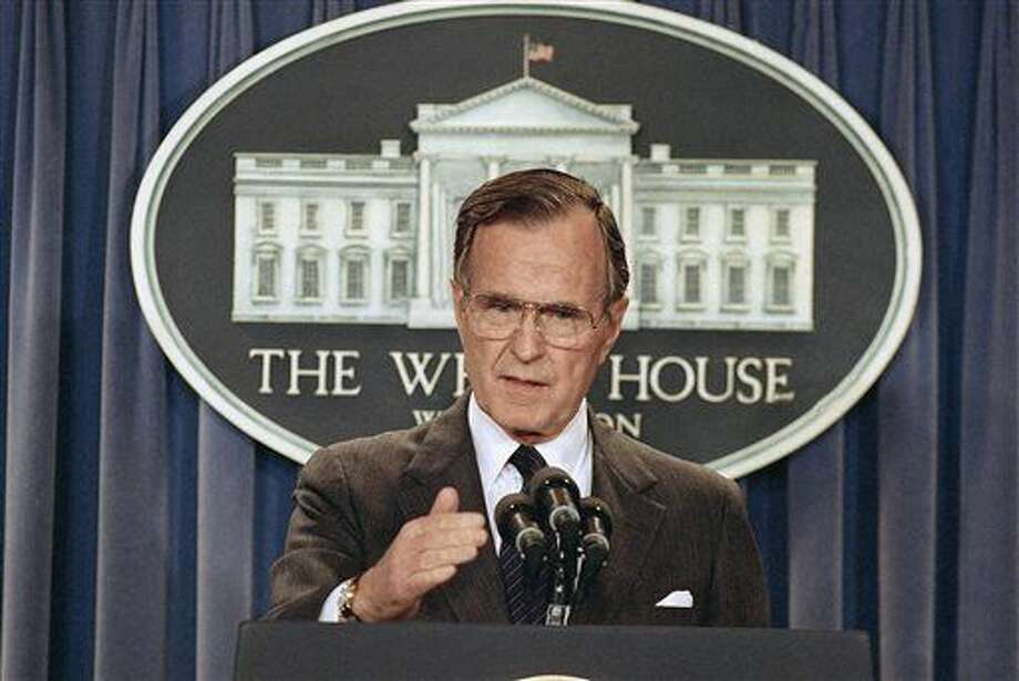 FILE - In this Thursday, May 11, 1989, file photo, President George H.W. Bush briefs reporters at the White House in Washington. Former President George H.W. Bush was taken to a Houston hospital after experiencing a shortness of breath on Tuesday, Dec. 23, 2014. (AP Photo/Doug Mills, File) Photo: Doug Mills