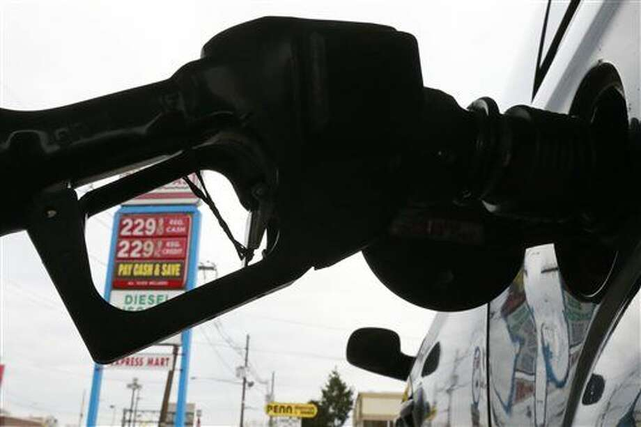FILE - In this Dec. 18  file photo, gas is pumped into a car at the Eastcoast filling station in Pennsauken N.J.  (AP Photo/Matt Rourke, File)