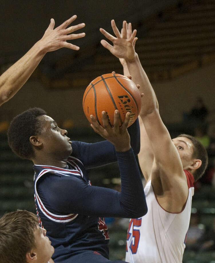 12-29-14 Plainview's Khalid Riggins drives the lane as El Paso Bel Air's Isiah Aguilera and teammates defend Moday at the Byron Johnston Holiday Classic at the Chaparral Center. Tim Fischer\Reporter-Telegram Photo: Tim Fischer
