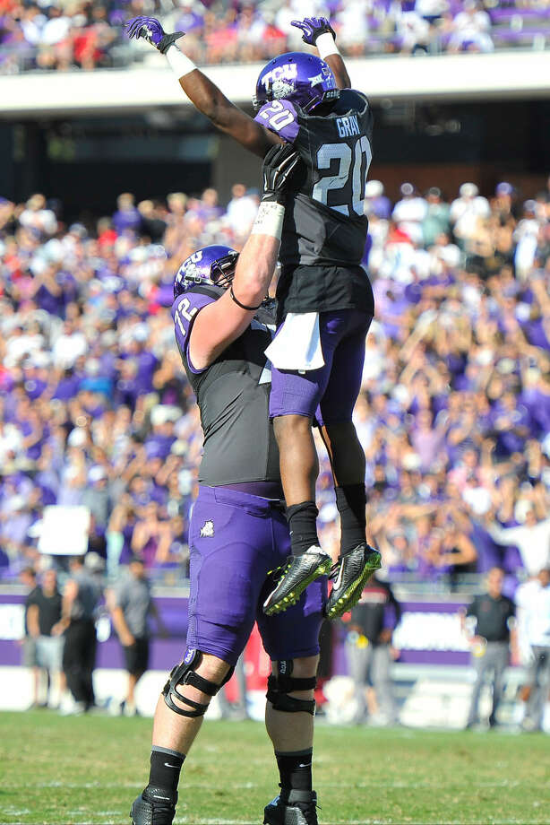 TCU offensive lineman and Midland Christian grad Bobby Thompson celebrates with teammate Deante' Gray against Texas Tech at Amon G. Carter Stadium in Fort Worth on October 25, 2014. Photos by Michael Clements. Photo: Michael Clements