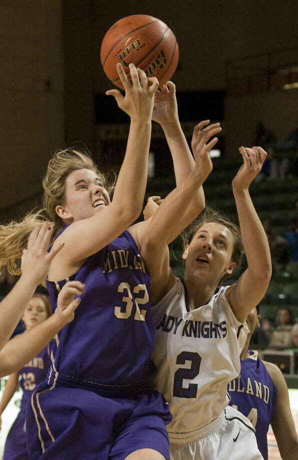 12-30-14 Midland High's Claire Lancaster goes up for a rebound as Midland Classical's Kristen Johnson goes for the ball Tuesday at the Byron Johnston Holiday Classic at the Chaparral Center. Tim Fischer\Reporter-Telegram Photo: Tim Fischer