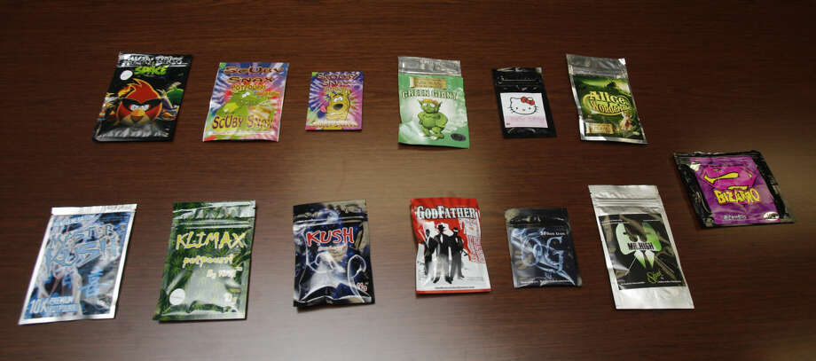Packets of so-called synthetic marijuana seized by the Drug Enforcement Administration shown Friday, Nov. 15, 2013, in Houston. Sold in smoke shops and other stores, it is marketed as potpourri or aromatherapy and labeled as unsafe for human consumption. However, authorities say everyone is in on the loophole, but that not everyone realizes the substances are dangerous, inconsistent, and can land users in the hospital. ( Melissa Phillip / Houston Chronicle ) Photo: Melissa Phillip