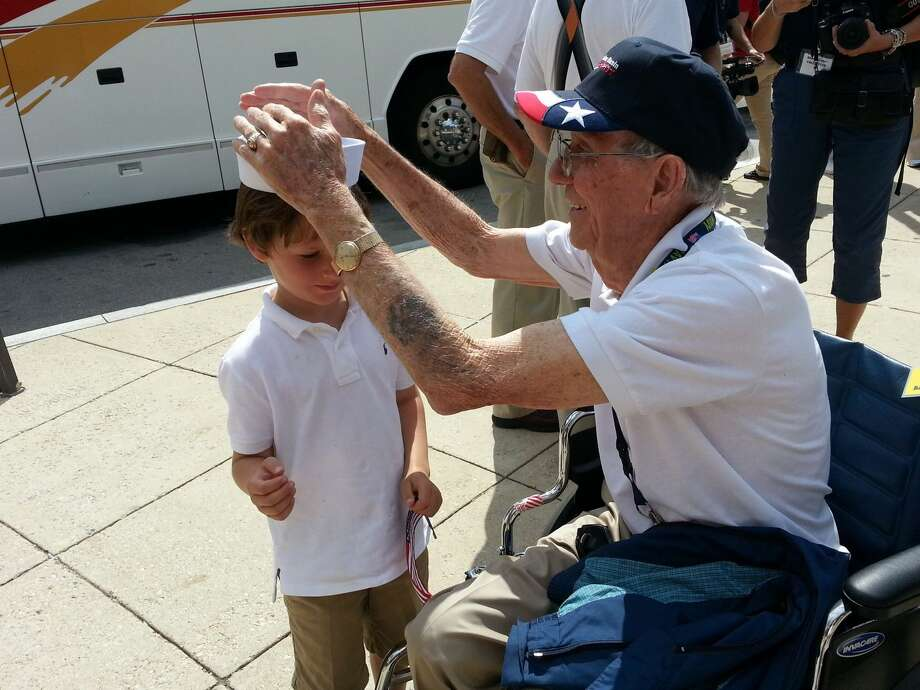 """John John"" Garner, 7, and his great grandfather Joe. B. White, 88, share a special moment outside the National World War II Memorial in Washington, D.C. Texas Permian Basin Honor Flight, held for the first in September, sparked discussions about connecting younger generations  Photo: Photo By Rachael Gleason/Reporter-Telegram"