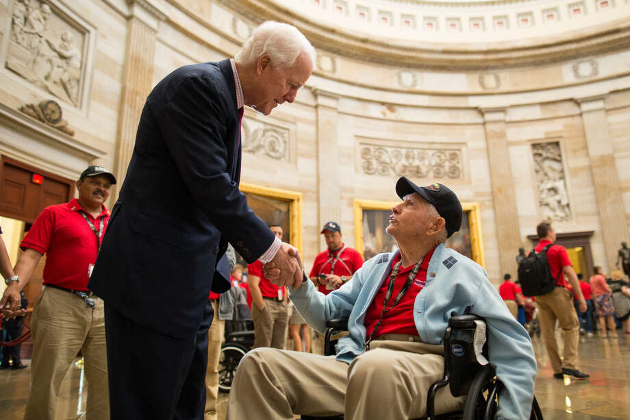 Senior United States Senator for Texas John Cornyn III shakes the hand of WWII veteran Tommy Flournoy in the U.S. Capitol Rotunda during the Texas Permian Basin Honor Flight's trip to Washington D.C. Courtney Sacco|Odessa American Photo: Courtney Sacco