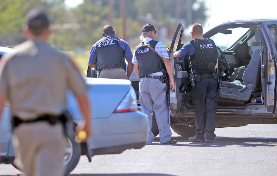 Midland emergency personnel respond to a standoff near Briarwod and 158 on Thursday. James Durbin/Reporter-Telegram Photo: James Durbin
