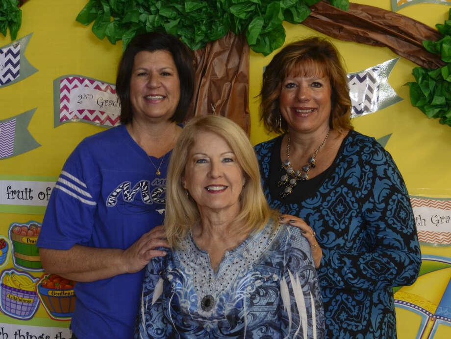 Midland Christian Elementary teachers, Kara Moore, Jan Lary, front and Terri Patton are all breast cancer survivors. Tim Fischer\Reporter-Telegram Photo: Tim Fischer