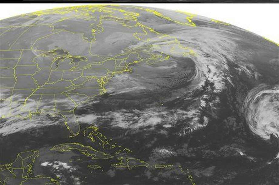 This NOAA satellite image taken Friday, Dec. 19, 2014 at 12:45 a.m. EST shows a cold front across Southeastern United States producing rain showers across the Lower Mississippi Valley and also some thunderstorms over Eastern Texas. Lake effect snow showers are across Western New York, Pennsylvania and Ohio. (AP PHOTO/WEATHER UNDERGROUND) Photo: HOPD