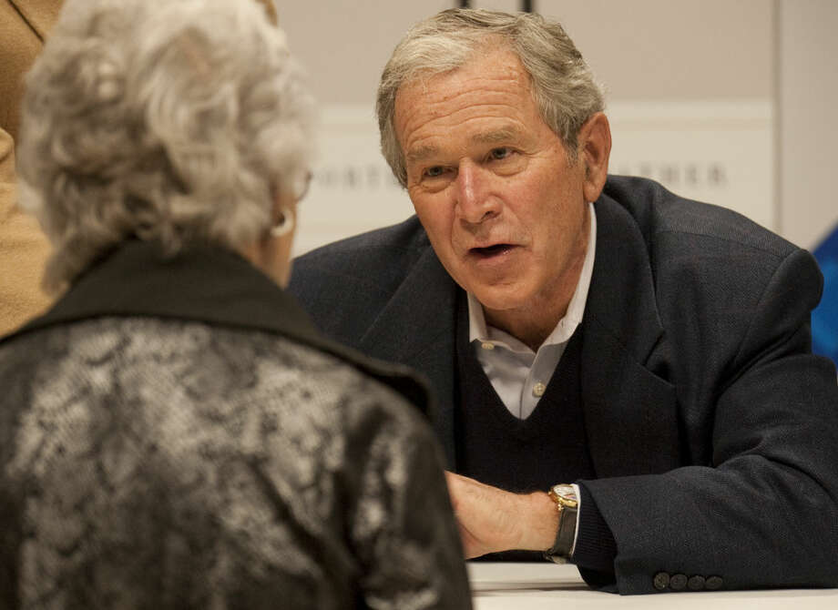 George W. Bush signs copies of his book, 41 and greets patrons who purchased a copy Monday at Sam's Club. Tim Fischer\Reporter-Telegram Photo: Tim Fischer