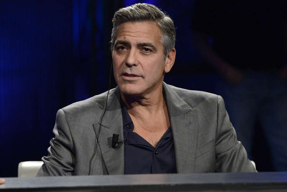 "This Sunday, Feb. 9, 2014 file photo shows American actor George Clooney interviewed by Fabio Fazio during the Italian State RAI TV program ""Che Tempo che Fa"", in Milan, Italy. Hollywood's most eligible bachelor may be getting hitched. A London law firm on Monday April 28, 2014, has congratulated one of its lawyers on her engagement to George Clooney. (AP Photo/Giuseppe Aresu, File) Photo: Giuseppe Aresu"