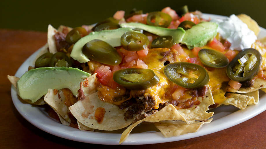 The Nachos Supreme at Checo's Mexican and American Grill in Houston. Photo: BOB OWEN