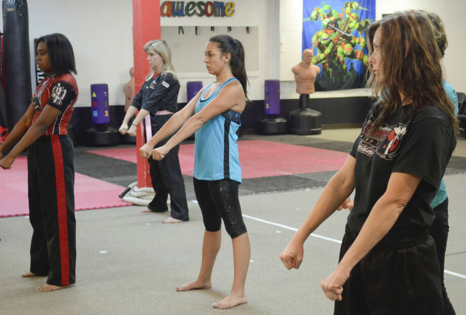 Women stand in ready stance Wednesday during a Lady Warriors class at Matthews Martial Arts. Tim Fischer\Reporter-Telegram Photo: Tim Fischer