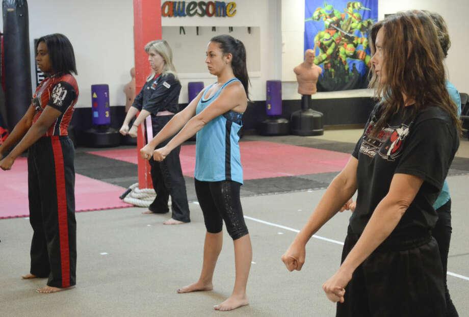 Women stand in ready stance Wednesday during a Lady Warriors class at Matthews Martial Arts. Tim Fischer\Reporter-Telegram Photo: Tim Fischer