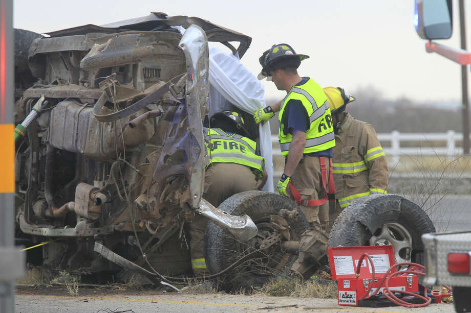 Midland emergency personnel work the scene of a fatal vehicle crash on the south service road of Interstate 20 on Wednesday. James Durbin/Reporter-Telegram Photo: James Durbin