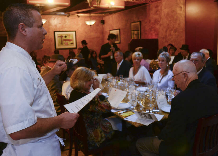 Chef and owner of Garlic Press explains the menu and answers any questions before the first course of the re-creation of the final meal served on the Titanic put on by the Wine Society of Texas Permian Basin Chapter at Garlic Press. Tim Fischer\Reporter-Telegram Photo: Tim Fischer