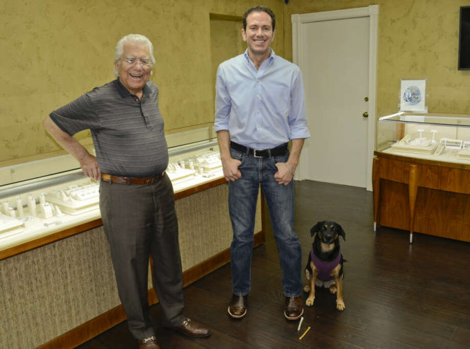 Emile Fanous, founder of Fanous Jewelers, stands with his son, Gregory and puppy Mila at the new Gregory Fanous Jewelers showroom in Midland. Tim Fischer\Reporter-Telegram Photo: Photographer