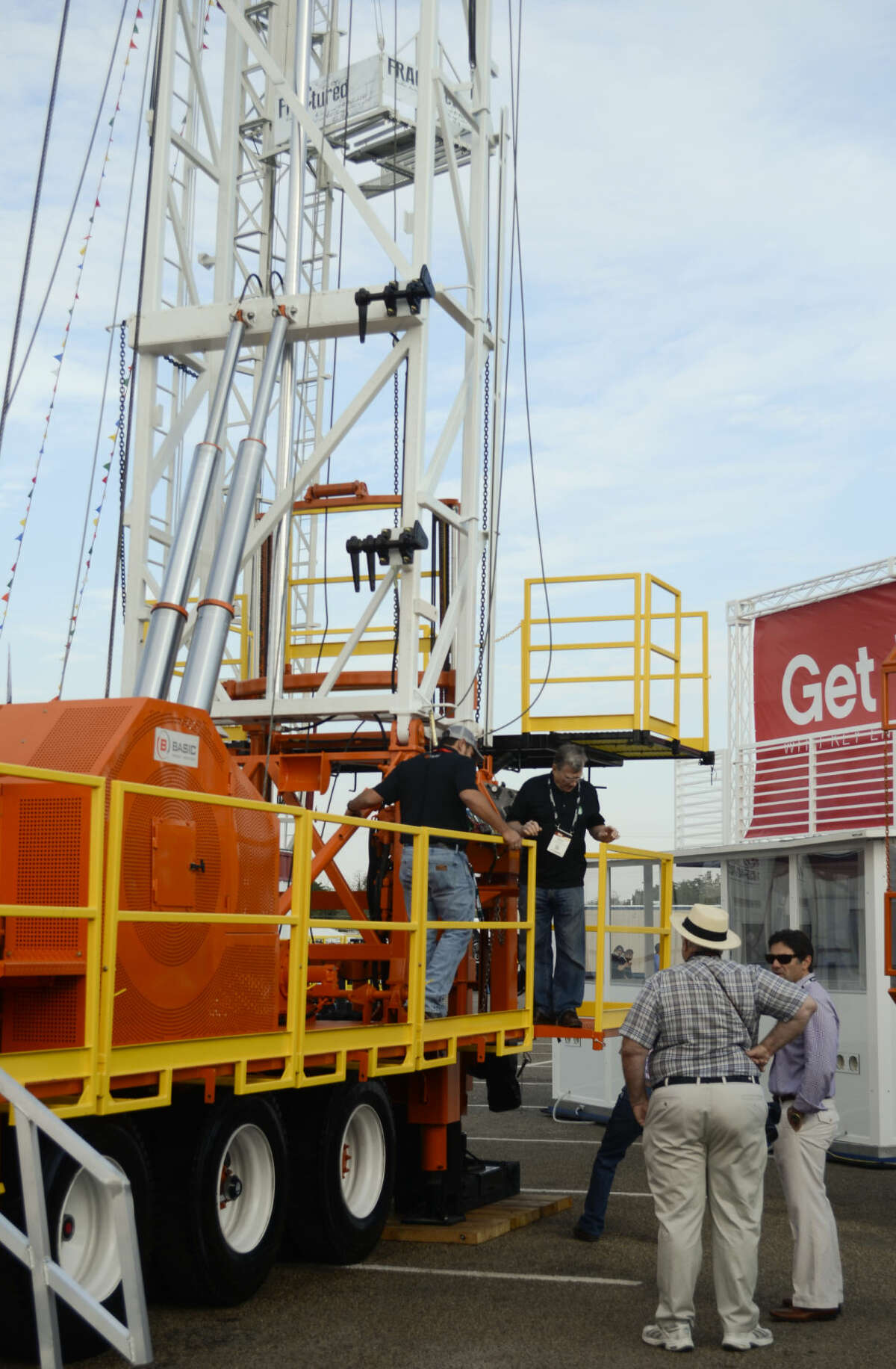 Atendees look at various equipment and rigs Tuesday during the PBIOS at Ector County Collisium. Tim Fischer\Reporter-Telegram