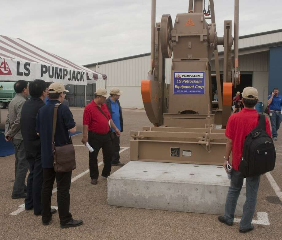 Oil and gas industry vendors from around the country and world talk with prospective clients Tuesday morning at the Permian Basin International Oil Show in Odessa. Tim Fischer\Reporter-Telegram Photo: Tim Fischer